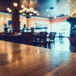 restaurant with abstract bokeh light blur background for create montage product display. Vintage tone