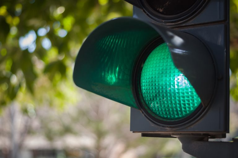 green sign traffic light in the city